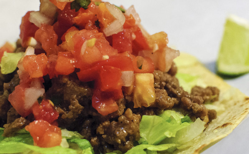 RASPADA CORN TOSTADA WITH PICADILLO